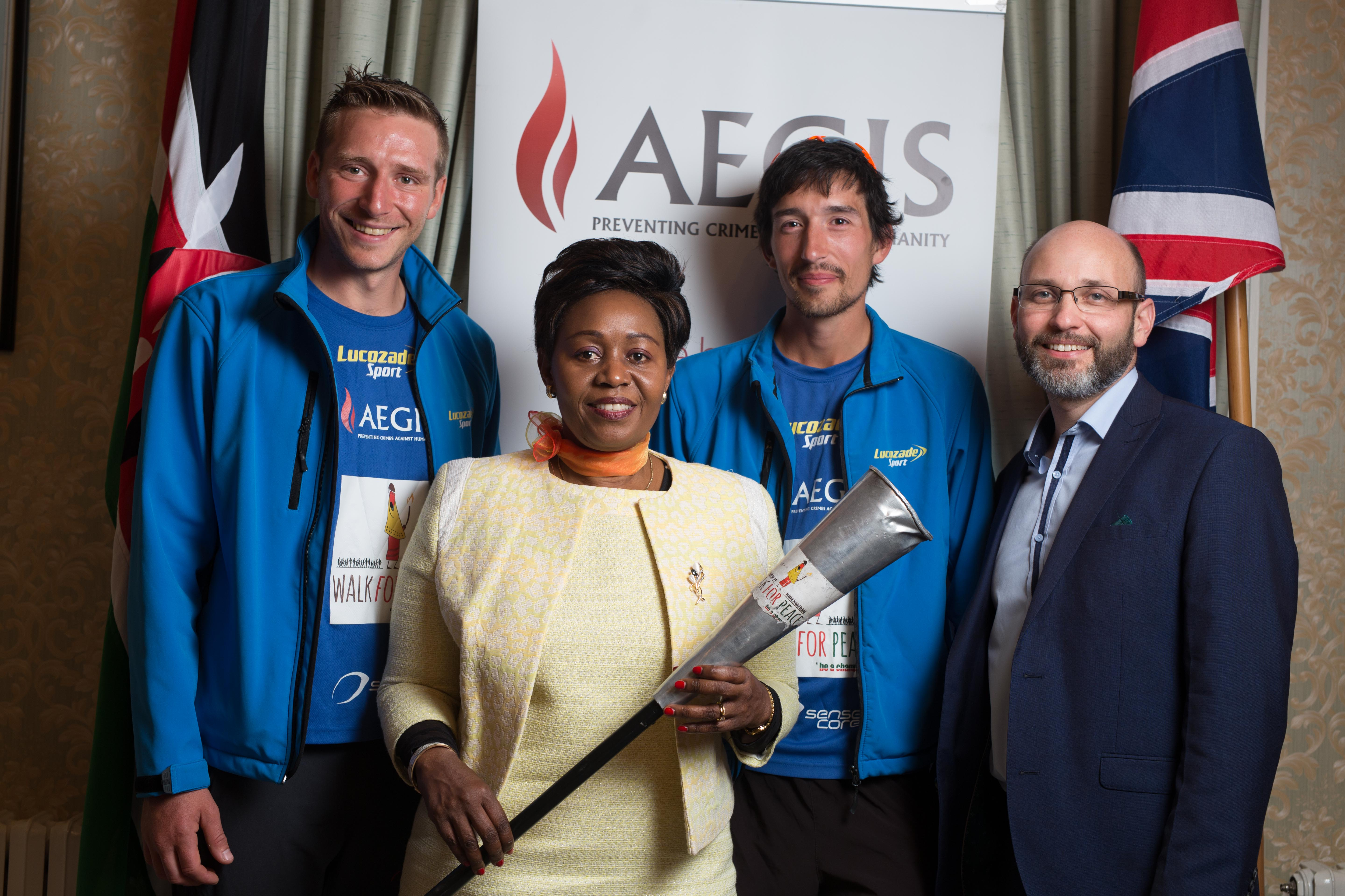 L-R: Rob Young (Marathon Man UK), Ambassador Jackline Yonga, Adam 'Tango' Holland, and Dr James Smith, CEO of the Aegis Trust, at Kenya's High Commission in London as Young and Holland present the Ambassador with the Torch for Humanity at the conclusion of their 2200-mile relay for the Champions Walk for Peace (www.walkforpeace.co.ke)