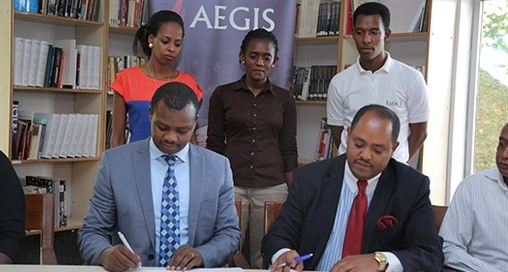 Freddy Mutanguha of the Aegis Trust signs MoU with Ambassador Mussie Hailu for URI Africa