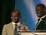 UN Ambassador Victor Ochen presents Aegis Regional Director Freddy Mutanguha with the inaugural Peace, Justice and Security Award in the Hague, 5 Sept 2016