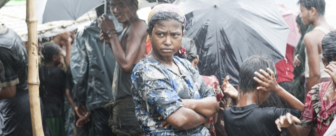 The UK could do more to help prevent atrocities such as those now being experienced by the Rohingya. (Picture: Rohingya woman in the rain, Steve Gumaer, CC BY-NC 2.0)