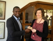 HE Helena Rietz receives Ubumuntu pin badge from Aegis Africa Representative Freddy Mutanguha at the Kigali Genocide Memorial, November 2018