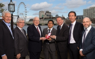 left-right Peter Freeman, Steve Noah, Ambassador Kenneth Quinn, Sokphal Din Cambodian genocide survivor, Lord David Alton, Sir Trevor Pears and Dr James Smith at the House of Lords as Ambassador Quinn receives the Steven Krulis Champion of Humanity Distinguished Service Award from the Aegis Trust in recognition of his work in countering the Khmer Rouge in Cambodia.