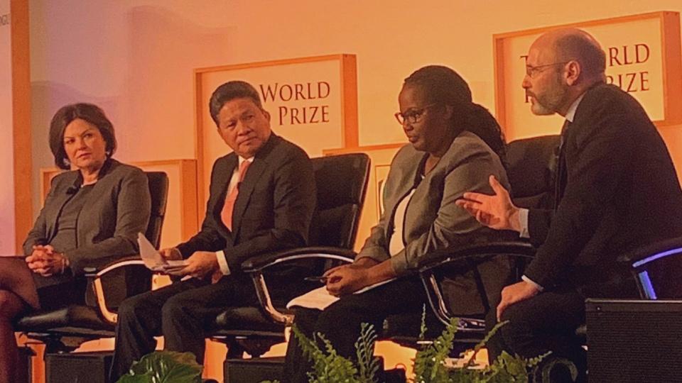 Dr James Smith (right) speaking at the Borlaug Dialogue in Iowa, October 2019 with Ms Heidi Kuhn, CEO of Roots of Peace; Hon Dr Gerardine Mukeshimana, Minister of Agriculture and Animal Resources, Rwanda; and Hon Chanthol Sun, Minister of Public Works and Transportation, Cambodia.